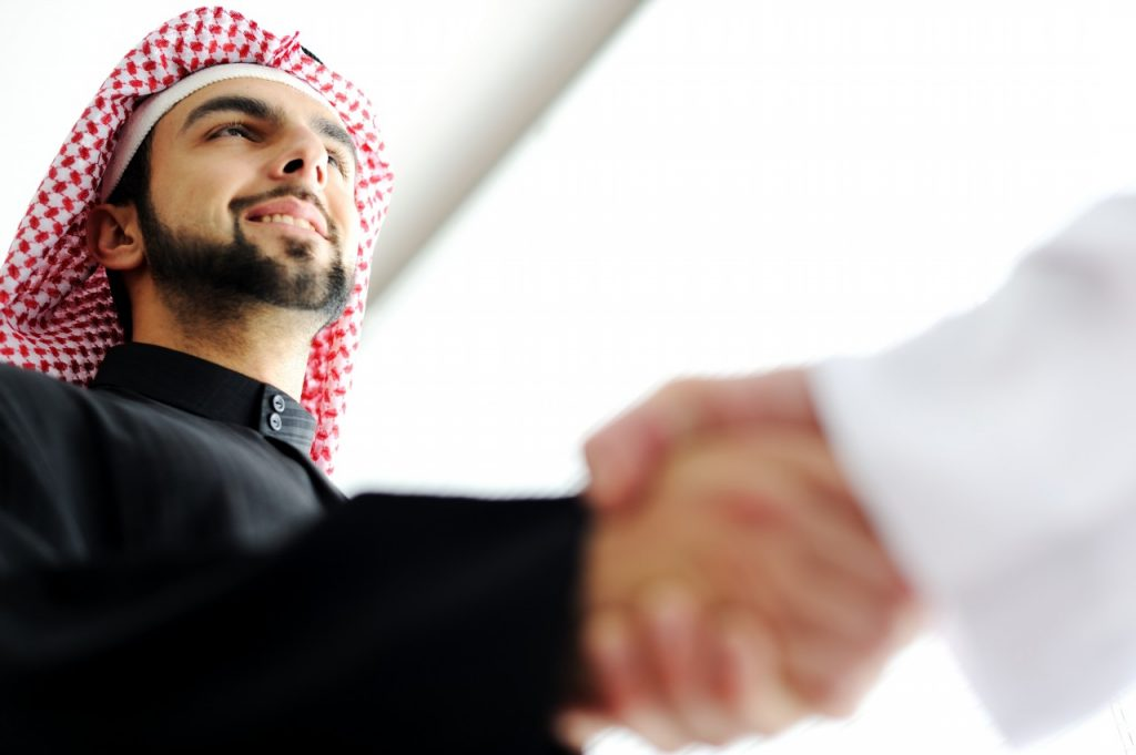 successful-arab-business-people-shaking-hands-over-a-deal